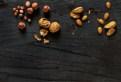 Nuts on black background - p312m2092062 by Pernille Tofte