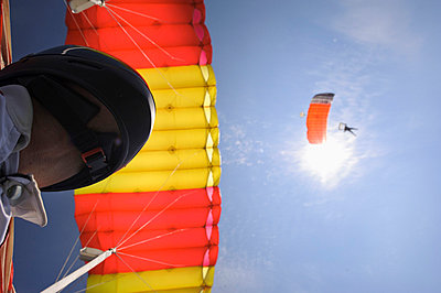 Paragliders, low angle view - p312m719935 by Hans Berggren