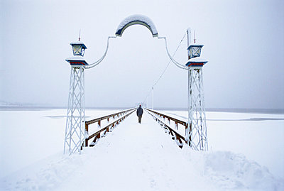 Jetty covered in snow, Sweden. - p5754425f by Berit Djuse