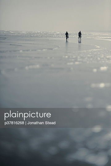 Two figures on beach - p37816268 by Jonathan Stead