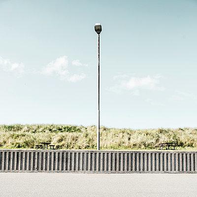 Street lamp in front of dunes, Hvide Sande - p1162m2281071 by Ralf Wilken