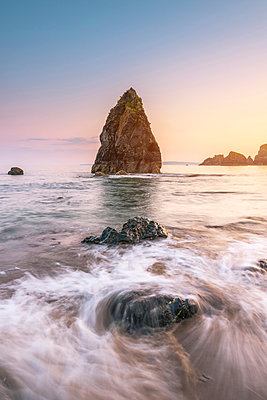 Ballydowane Cove, County Waterford, Munster province, Ireland, Europe. The sea stack in the ocean with the high tide. - p651m2007370 by Marco Bottigelli
