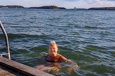 Woman swimming in sea - p312m2145952 by Pernille Tofte