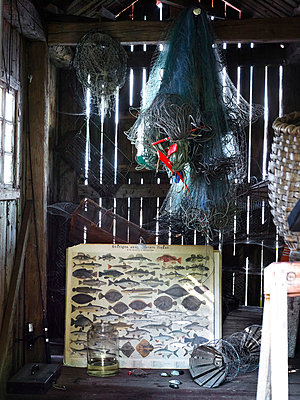 Fishing equipment in shed - p312m826972 by Anna Kern