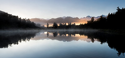 Lake Matheson panoramic at sunrise with Mount Cook, South Island, New Zealand, - p871m2068604 by Ed Rhodes