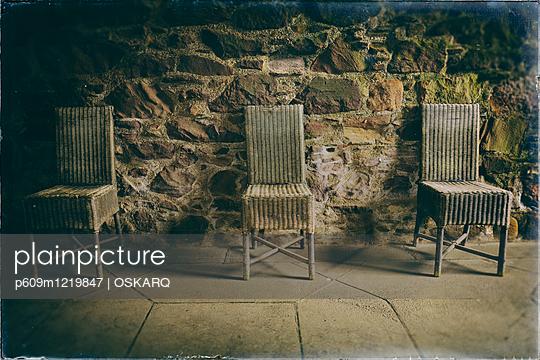 Old wicker chairs row castle room dark spooky - p609m1219847 by OSKARQ