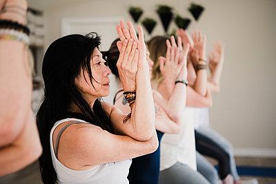 Women at yoga retreat - p429m2019527 by Hugh Whitaker
