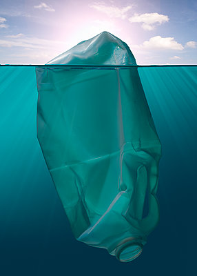 Plastic bottle floating in the sea - p1652m2257774 by Callum Ollason