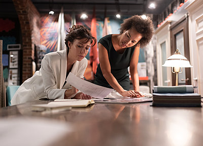 Multiethnic designers discussing project in workplace - p1166m2227655 by Cavan Images