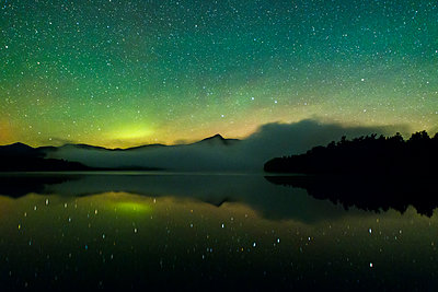 Northern light over mountain and sea - p343m1475840 by Adam Woodworth