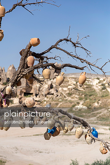 Many clay pots hanging on a tree - p1108m2110981 by trubavin