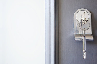 Close up of key in a front door - p92411542f by James French