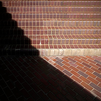 Steps in shadow - p1072m829223 by Neville Mountford-Hoare