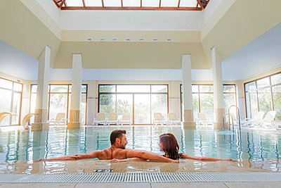 Couple relaxing in swimming pool of a spa - p300m2132226 by DREAMSTOCK1982