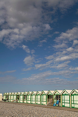 Row of beach huts - p3882246 by Ulrike Leyens
