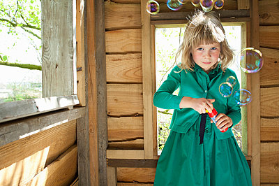 Girl playhouse with bubbles - p924m664993f by Mieke Dalle