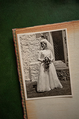 Vintage 1960s B&W photograph of a bride in her wedding dress - p1047m2126345 by Sally Mundy