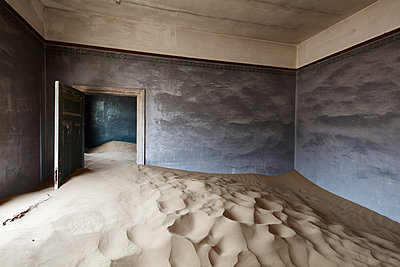 Interior of an abandoned building full of sand. - p1100m1489991 by Mint Images