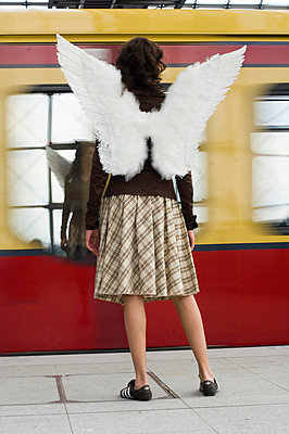 Woman with angel wings on platform - p4903101 by Felbert+Eickenberg