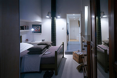 Low level lighting in a modern bedroom. - p8551958 by David Churchill