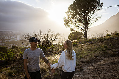 Couple goes on an excursion at sunset - p1640m2261001 by Holly & John