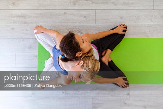 Prenatal yoga, female yoga instructor, reclining