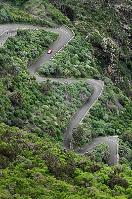 hairpin bends on mountain pass - p1280m1562081 by Dave Wall