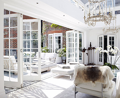 Air circulation from courtyard garden to conservatory extension in London home - p349m790414 by Brent Darby