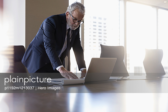 Lawyer working at laptop in conference room