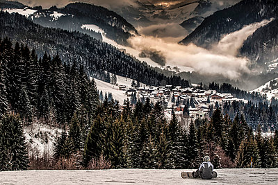 After a day of skiing at sunset above mountain village - p1072m954943f by Grigore Roibu