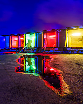 Colorful illuminated buildings at night - p312m1103932f by Mikael Svensson