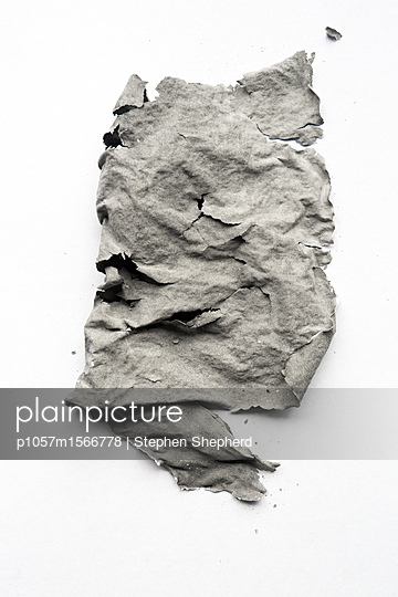 A sheet of burnt paper turned to a sheet of ash after being burnt in a close up studio style detailed image. - p1057m1566778 by Stephen Shepherd