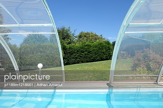 Swimming pool with glass roofing - p1189m1218661 by Adnan Arnaout