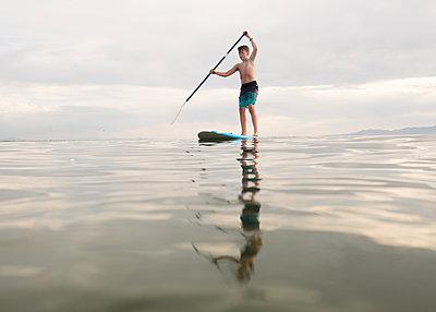 Boy Paddle Boarding - p1503m2015869 by Deb Schwedhelm
