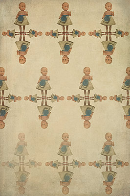 Computer generated abstract repeated pattern using 1950s toy doll in apron on sepia background - p1047m2222997 by Sally Mundy
