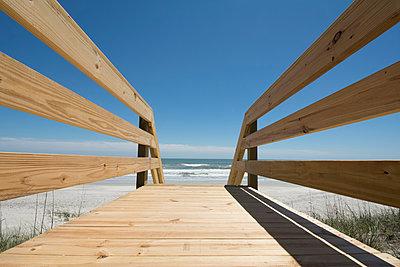 USA, North Carolina, Topsail Island, Boardwalk leading to beach - p1427m1504364 by Chris  Hackett
