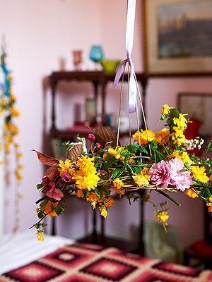 Cut flowers on ribbon in bedroom of Isle of Wight home;  UK - p349m920097 by Rachel Whiting
