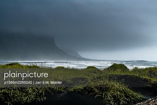 Coast with rain clouds - p1585m2285240 by Jan Erik Waider