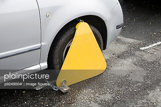 Clamped car - p9249004f by Image Source