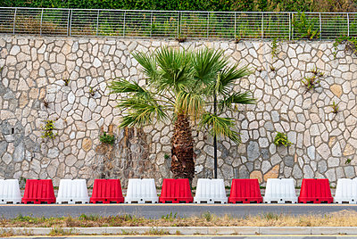 Italy, Road block and Palm tree - p564m2284405 by Dona