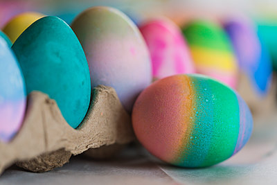 Close-up of colorful Easter eggs on table at home - p1166m2001034 by Cavan Images