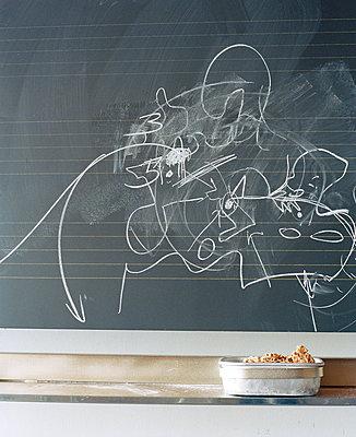 Scribbling on blackboard - p1629m2211315 by martinameier