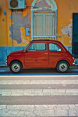 Italy, Apulia, Old Fiat 500 parked on crosswalk - p300m878103 by Dirk Kittelberger