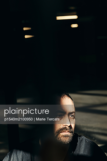 Bearded man in a dramatic atmosphere  - p1540m2100950 by Marie Tercafs