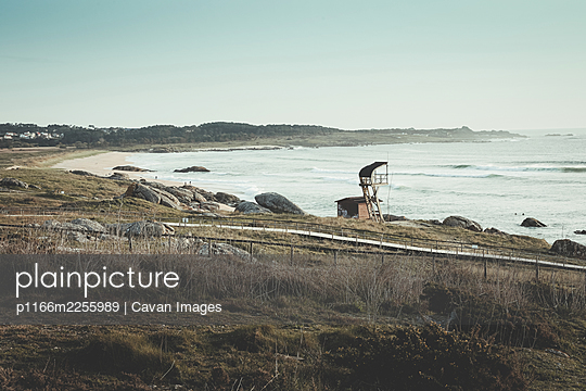 Vertical photo of Vilar beach with waves, rocks and sand - p1166m2255989 by Cavan Images