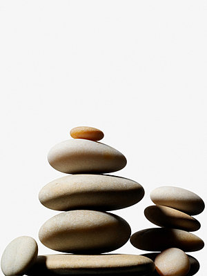Stacks of pebbles - p9247597f by Image Source