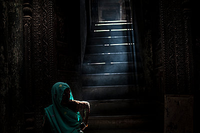 Woman in the stairs - p1007m1144421 by Tilby Vattard