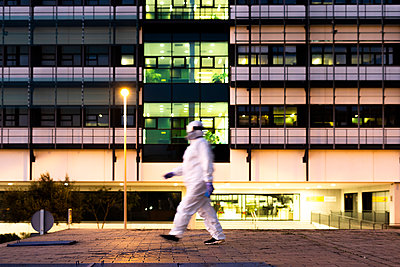 Female scientist wearing protective suit and mask in front of a laboratory - p300m2170813 by Eloisa Ramos