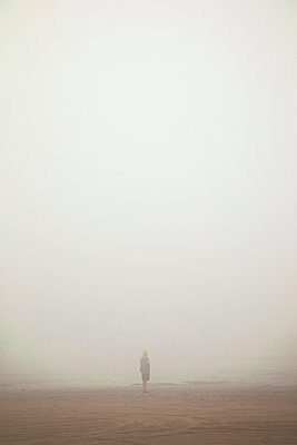 Beach walk in the fog - p382m1591169 by Anna Matzen