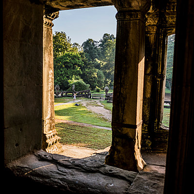 Man in the garden of Angkor Wat temple, Siem Reap, Cambodia - p924m1197534 by Rosanna U